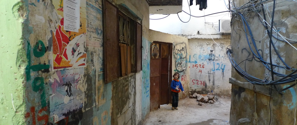 Kid_in_the_refugee_camp_of_Bourj_el-Barajneh_-_Flickr_-_Al_Jazeera_English